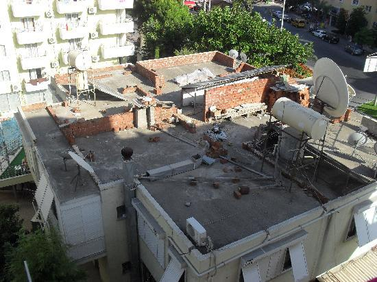 Tac Premier Hotel and Spa: View from our room, a building site roof