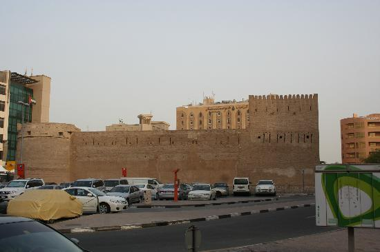 Arabian Courtyard Hotel & Spa: The Old Fort with Arabian Courtyard Hotel beyond