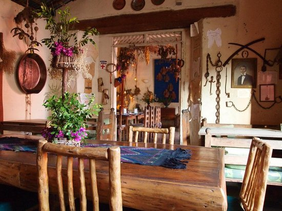 Cafe de Conchis: Across the dining room, wall where William Walker was chained