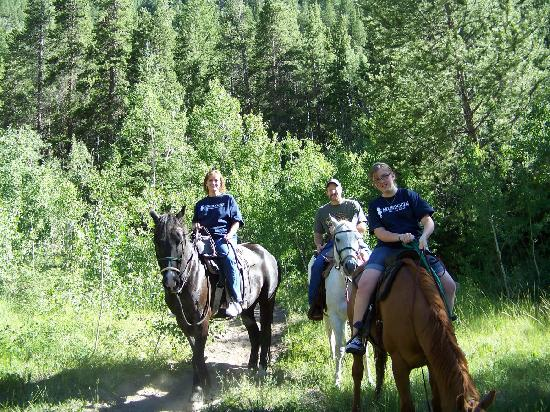 Harvard City Riding Stables: Kim, Aaron, and Megan.