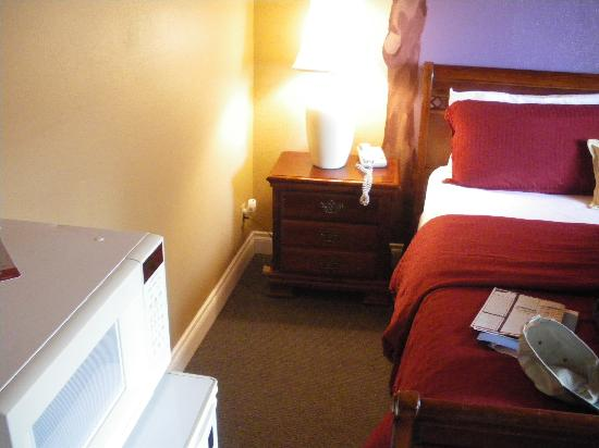 "Anchorage Downtown Hotel: Microwave on refrigerator in ""deluxe suite."""