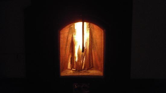 Kluney Manor: The fireplace in the bedroom