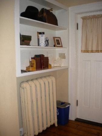 Shipwright Inn: Antiques in Purser's room, along with door to shared balconey