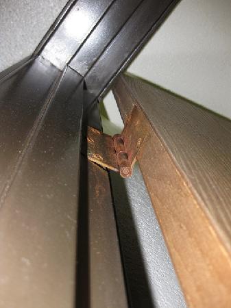 Pueblo, CO: Bathroom door hinge hanging on