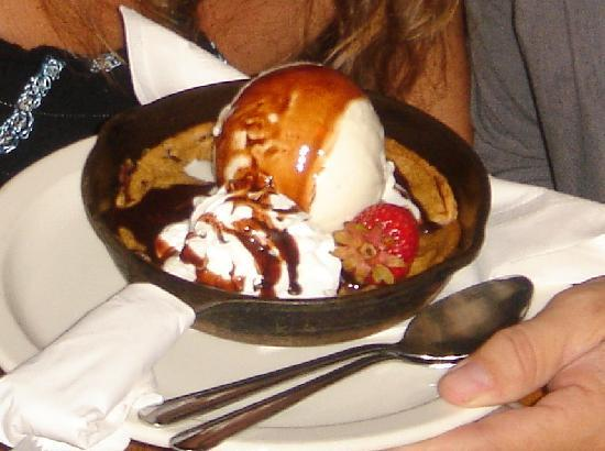 Saddle Ranch Chop House: Dessert - half baked cookie with ice cream, whipped cream, and chocolate sauce