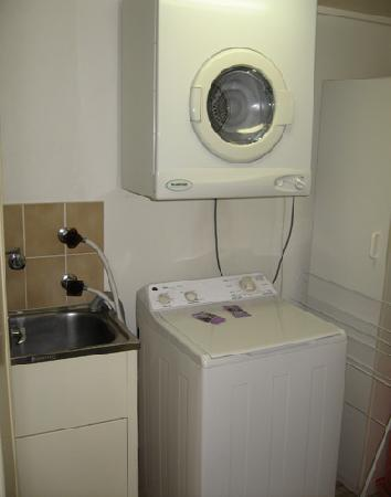BreakFree Imperial Surf: Apartment 11-C Laundry Room