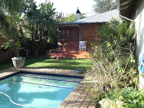 Ambiance Guest House: pool and garden