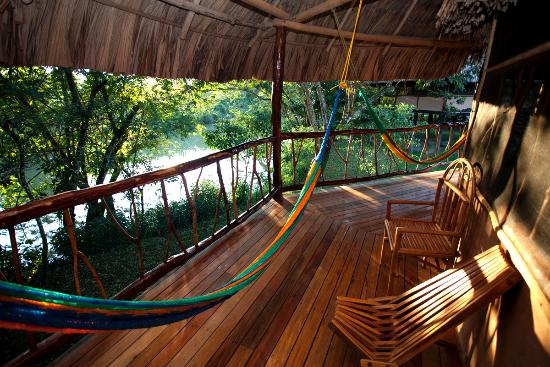 Cotton Tree Lodge: Most cabanas have private verandas with hammocks facing the river