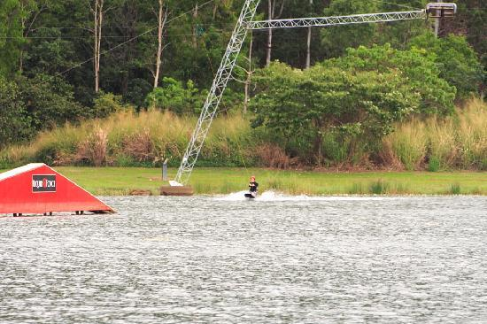 Cable Ski Cairns: Here's a kneeboarder at the far end of the lake.  You can see the overhead tow cable.