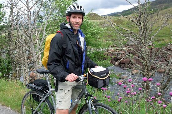 """2 Wheel Tours: Traveling by bike we got to really """"stop and smell the roses.""""  Or, in our case, thistles!"""