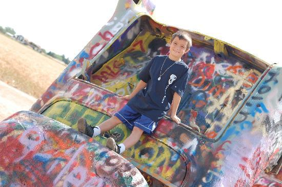 Amarillo, TX: My son Zachary at the Cadillac Ranch