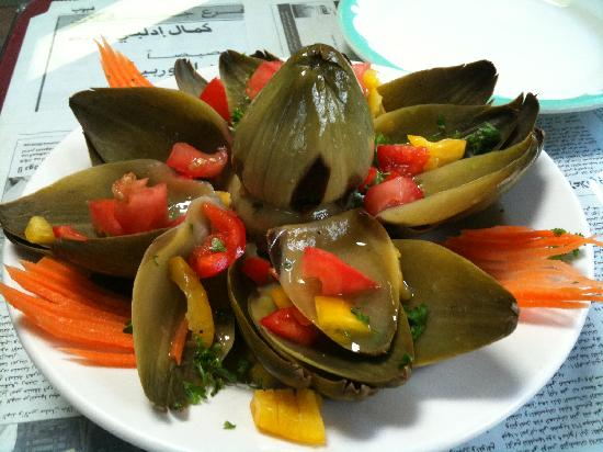Naji's: Artichoke, steamed, drizzled with seasoned oil and topped with tomatoes