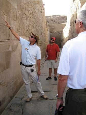 Nile River: Tour guide explaining heiroglyphs at Sobek Temple