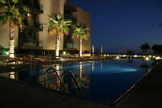 Golden Residence: Pool view at dusk