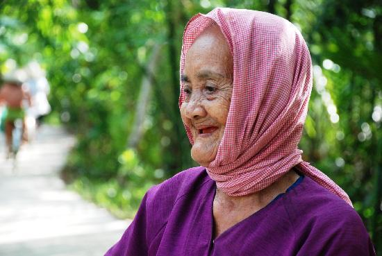 Delta del Mekong, Vietnam: Old lady at My Tho, Mekong delta