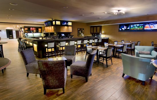 """Bistro 933: Bar area with 4 - 42"""" HD TVs"""
