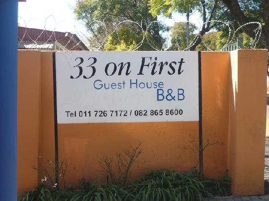 33 on First Guest House: Guest House Sign