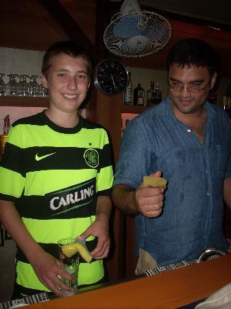 High Life Apartments: Sean with Ris behind the bar