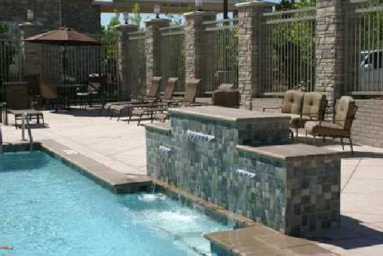 Hilton Garden Inn Denton: Our outdoor pool waterfall has benching seating beneath it so you can enjoy the cascading water.
