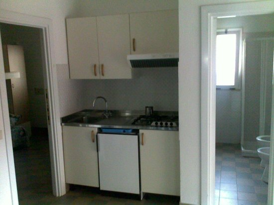 Salinello Village: Kitchenette with door opened to the Camera (third room)