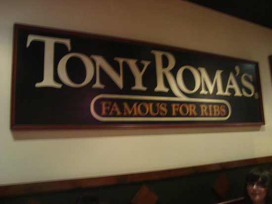 Tony Romas: Sign on the wall in the resturant