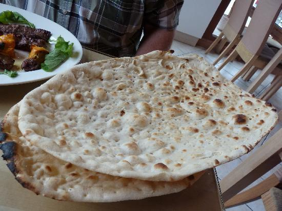Alborz Restaurant: Naan breads, Huge, crunchy, freshly made.