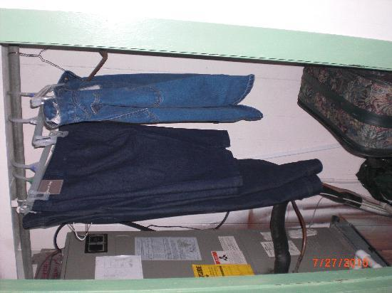 Beachcomber: Closet in bedroom. Note the missing door and exposed pipes and wires.