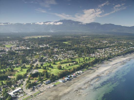 An aerial view of Qualicum Beach with Mount Arrowsmith in the background