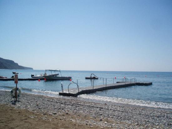 Columbia Beach Resort Pissouri: The beach floating station excellent to sun bath on and for the kids to jump off and snorkle aro