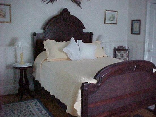 The Dominion House: One of three guests rooms in main house furnished with original antiques.