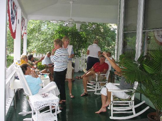 Hot Springs, VA: Golfers gathered on the front porch for a cocktail party