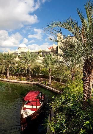 Shangri-La Hotel, Qaryat Al Beri, Abu Dhabi: Abra on waterway with garden