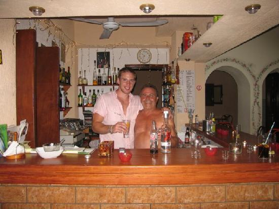 Elounda Heights Apartments and Studios: Behind the bar with Vangelli