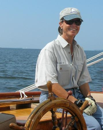 St. Michaels, MD: Captain Iris at the helm