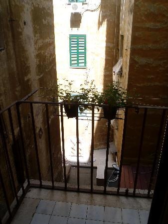 Obelus B&B: View from our balcony... Such an Italy feel, loved it!