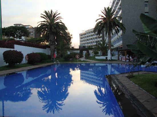 Interpalace by Blue Sea: The pool and pool bar at dusk