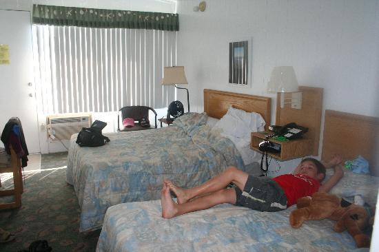 Sea Gull Motel: My grandson on the bed in our room