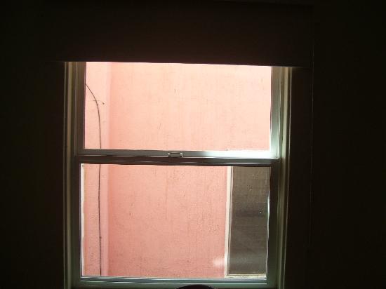 Cadillac Hotel: broken window