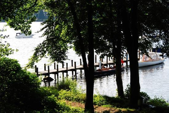 Storrs Lodges: View of the hotel jetty down through the trees from the lodges