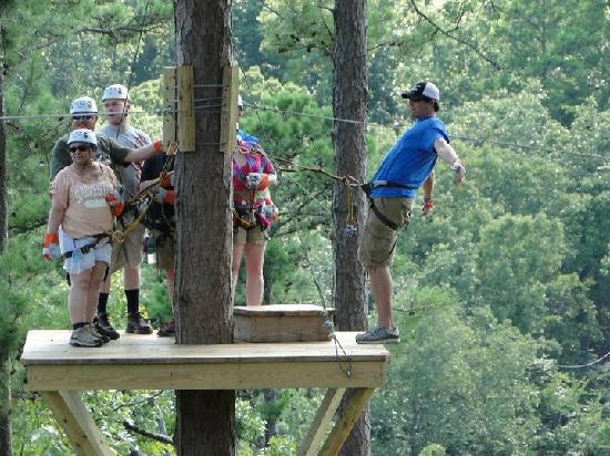 """New York Texas Zipline Adventures: One of the """"stops"""" along the way- Josh is in the blue"""