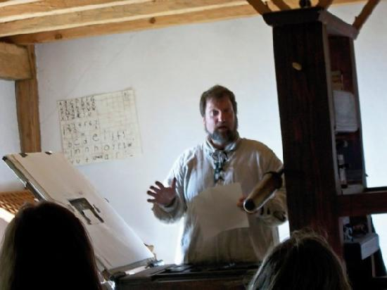 Saint Mary's City, MD: This man explains the innovation, use, and care of a printing press.