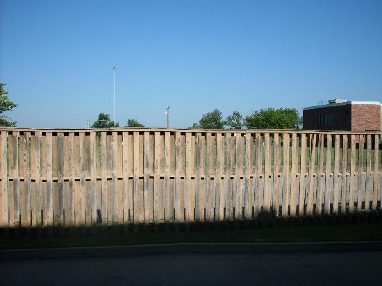 Quality Inn: Dilapidated Exterior Fencing