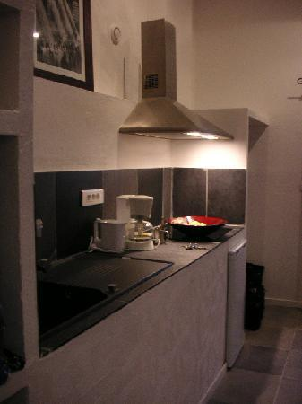 Auberge de La Poulciere: View of kitchenarea from bathroom
