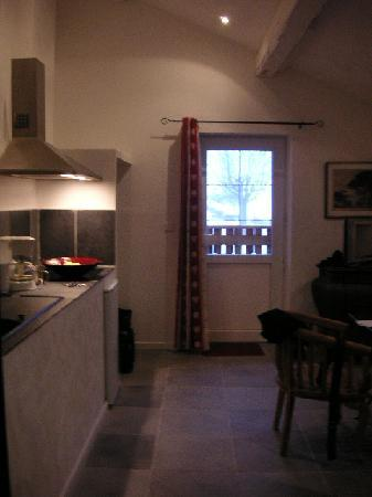 Auberge de La Poulciere: Kitchenarea viewed from bathroom
