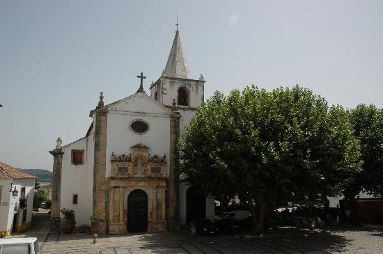 Obidos, Portugal: churches and squares with shady trees