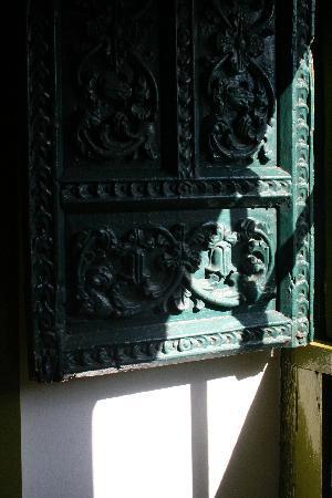 "Niños Hotel: Beautiful colonial-era window shutter in ""Pieter"""