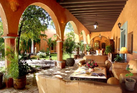 Hacienda De Los Santos: One of many Hacienda exterior seating areas