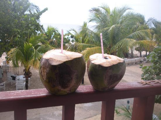 Enjoying some coconut water on our deck at Couples Swept Away
