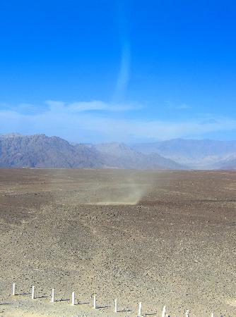 Nazca dust devil over roadside lines