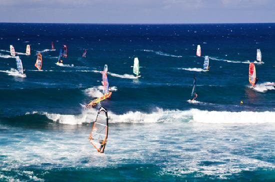 Maui, HI: Enjoy an afternoon watching the windsurfers at Hookipa beach in Paia.